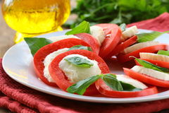 Italian salad with mozzarella cheese Royalty Free Stock Images