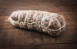 Italian salami closeup on wooden background Stock Image