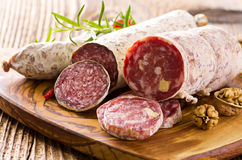 Italian Salami. Collection as closeup on a wooden board royalty free stock images