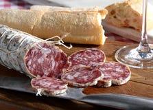 Italian salami and fresh bread Stock Photos