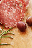 Italian salami and herbs Royalty Free Stock Image