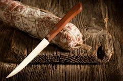 Italian salami with knife royalty free stock photos