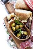Italian salami with olives and ciabatta stock photography