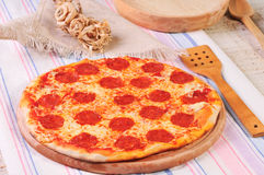 Italian salami pizza on table Stock Photos