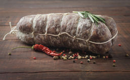 Italian salami with red pepper and rosemary Stock Photography