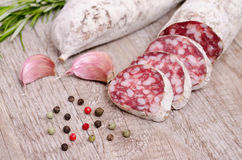 Salami sausage with condiments Royalty Free Stock Images