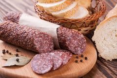 Italian salami sliced on wooden table Stock Images