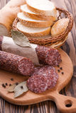 Italian salami sliced on wooden table Royalty Free Stock Photos