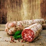 Italian salami. On a wooden board Stock Photography