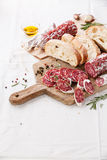 Italian salami. On wooden cutting Board stock photos