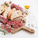 Italian salami. On wooden cutting Board stock image