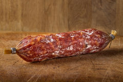 Italian salami on wooden cutting board Royalty Free Stock Images