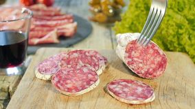 Italian salami on wooden cutting Board stock video footage