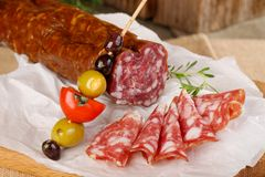 Italian Salami. On the wooden table royalty free stock images