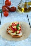 Italian sandwich - Bruschetta. The table is Italian sandwich - Bruschetta Stock Photography
