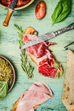 Italian sandwich with ham, cured meat and pesto , top view Royalty Free Stock Image