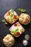 Italian sandwich with ham, Multicolored cherry tomatoes, basil. Stock Photo