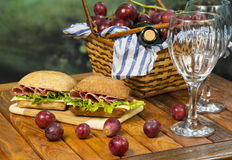 Italian sandwich with picnic basket Royalty Free Stock Images