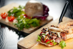 Italian Sandwich with Sausage and Eggplant. A typical italian sandwich called saltimbocca filled with grilled pork sausage and fried eggplant and fresh Stock Photo