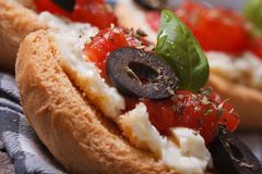 Italian sandwich with tomatoes, feta cheese and olives Royalty Free Stock Photos
