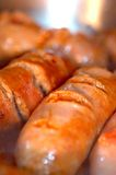 Italian sausage frying Stock Images