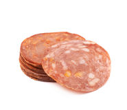 Italian sausage salame napoli isolated. Pile of multiple Italian sausage salame napoli slices isolated over the white background royalty free stock image