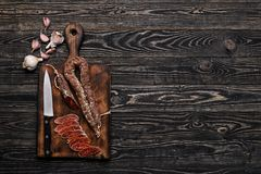 Italian sausage sausage,knife and garlic Royalty Free Stock Image