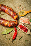 Italian sausage and spices Royalty Free Stock Photo