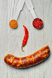 Italian sausage and spices smiley Stock Images
