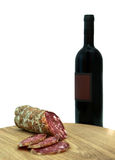 Italian sausage and wine bottle Stock Image