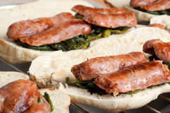 Italian Sausages with fried Broccoli and Sandwich Royalty Free Stock Photography
