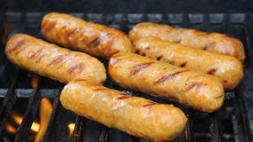 Italian sausages on grill Stock Photo