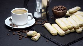 Italian Savoiardi ladyfingers Biscuits and cup of coffee on concrete background. Traditional Italian Savoiardi ladyfingers Biscuits and cup of coffee on concrete stock footage