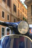 Italian Scooter. Italian motorbike/scooter in Rome,Italy with buildings to background royalty free stock photos