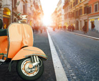 Italian scooter and old building style in rome use as traveling Royalty Free Stock Image