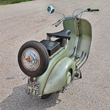 Italian scooter Vespa 125 (1950). Vintage Italian scooter Vespa 125 (1950) in classic car and motorcycle rally 15' auto moto raduno on April 25, 2015 in Stock Photo
