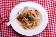 Italian seafood spaghetti. Stock Photos