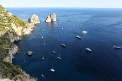 Italian seascape with rocks and ships Stock Image