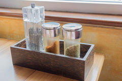 Italian seasoning - Pepper, chili powder and origano. In wooden box Stock Photography