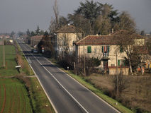 Italian secondary road with tipical houses Stock Photography