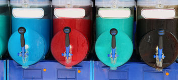 Italian shave ice machine with many colored flavors Stock Images