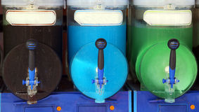 Italian shave ice machine with many flavors and iced at the bar Stock Image