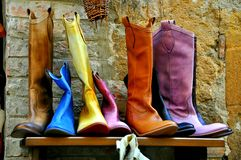Italian shoes on sale in Montepulciano. Tuscany.Colorful boots on a shelf for selling stock images