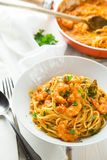 Italian shrimp and tomato sauce pasta stock photo
