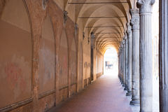 Italian sidewalk with ancient columns and old brick walls Royalty Free Stock Photos