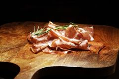 Italian sliced cured coppa with spices. Raw ham. Crudo or jamon cured cold meat. Italian sliced cured coppa with spices. Raw ham. Crudo or jamon. antipasto royalty free stock photos