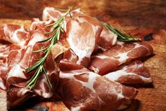 Italian sliced cured coppa with spices. Raw ham. Crudo or jamon cured cold meat. Italian sliced cured coppa with spices. Raw ham. Crudo or jamon. antipasto royalty free stock image