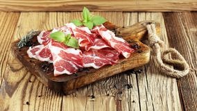 Italian sliced cured coppa with spices. Raw ham. Crudo or jamon.  royalty free stock images