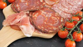 Italian sliced delicious salami. On wooden board stock video footage
