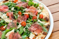 Italian smoked ham and rucola pizza. Stock Image